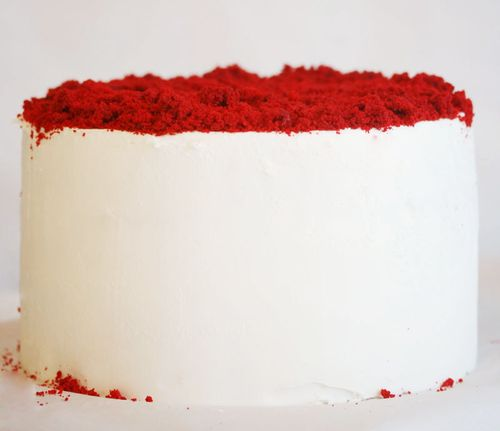 Heart Cake - white vanilla frosting covered white cake with red velvet cake crumbled on top