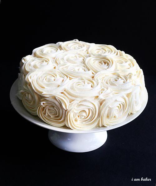 A very pretty rose frosted cake.